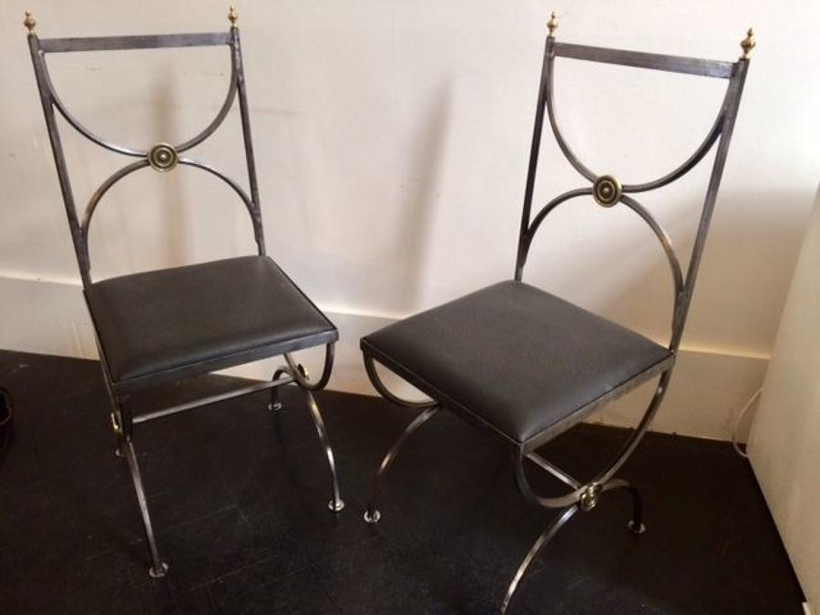 Pair of polished steel chairs